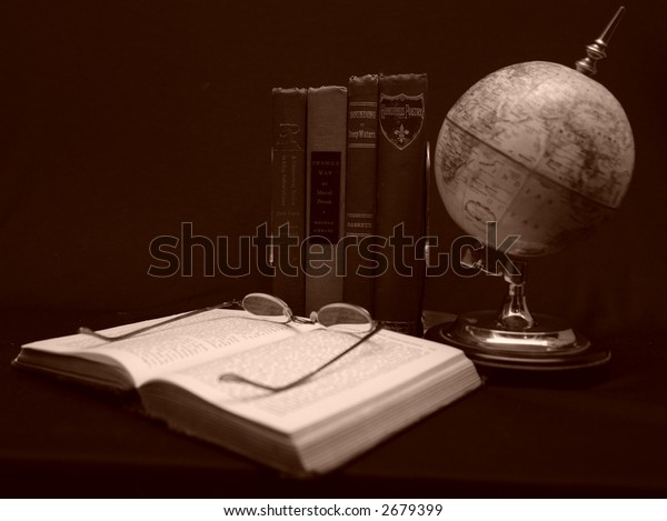 Photo of books with magnifying glass.