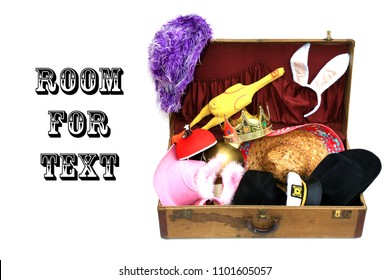 Photo Booth hats and props in an antique trunk. isolated on white. room for text. vintage hats and props in a suitcase.