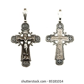 Photo of both parties of a silver orthodox cross on a white background