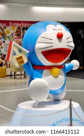 Photo of A boy is copying the Doraemon doll in the airport of Sapporo, Hokkaido Japan January 2, 2018