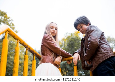 photo of Boy and girl teenagers in autumn park
