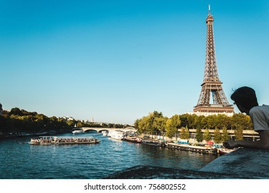 Photo of Boy Looking at Eiffel Tower and The Seine River in Paris, France