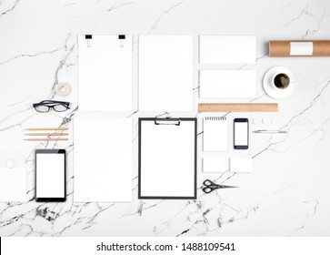 Photo of branding identity mock up on white marble. Template isolated on white marble background. For graphic designers presentations and portfolios marble premium luxury mock-up