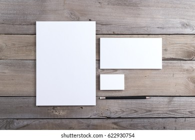 Photo of branding identity mock up. Template isolated on old wood background. For graphic designers presentations and portfolios damaged weathered antique mock-up.