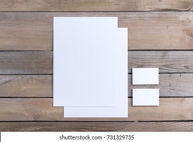 Photo of branding identity mock up. Template isolated on old wood background. For graphic designers presentations and portfolios damaged weathered antique mock-up