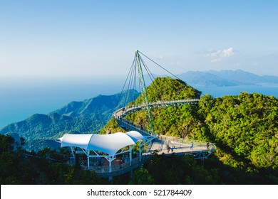Photo of the Breathtaking aerial view with cable-stayed bridge, symbol Langkawi, Malaysia. Adventure holiday. Modern technology. Tourist attraction. Travel concept.