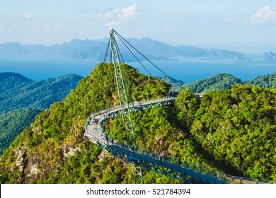 Photo of the Breathtaking aerial view with Sky bridge, symbol Langkawi, Malaysia. Adventure holiday. Modern technology. Tourist attraction. Travel concept. Andaman sea background