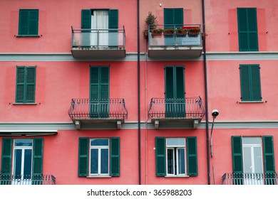 photo of a bright red facade in an Italian town