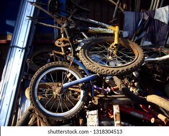 Photo of broken bicycles at a junkyard