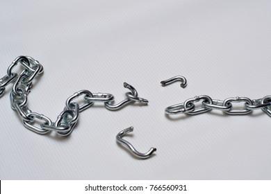 Photo of broken metallic chain on white background