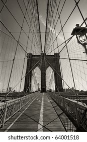Photo of the Brooklyn Bridge in New York city done in black and white.