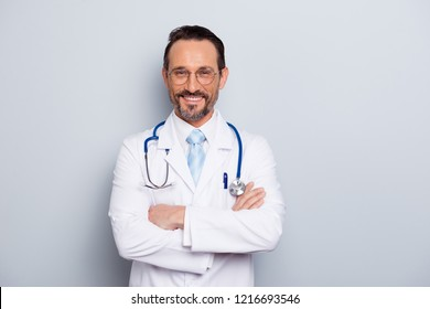 Photo of brunet hair bristle doc assistant folded hands over chest stand isolated on light gray background with hollywood smile