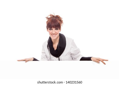 Photo of brunette doctor with white message board - isolated