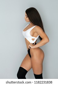 Photo of brunette woman with slim toned body. Beauty and body care concept