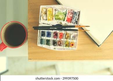 Photo of  brushes on watercolors