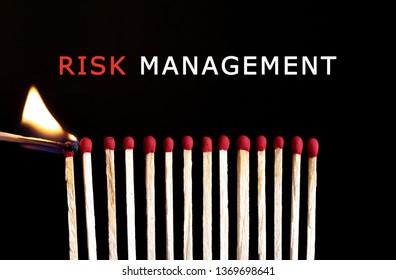 Photo of burning matchstick. Risk management concept.