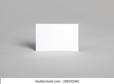 Photo of business card standing on the edge. Mock-up for branding identity. For graphic designers presentations and portfolios
