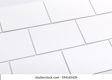 Photo of business cards isolated on white holding in hands. Business cards template for branding identity. Business cards For graphic designers presentations and portfolios. Branding, brand, template.