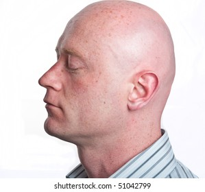 photo business man portrait in his 30's on white isolated. profile man male shaved head and eyes closed. close up face head profile of a white man.