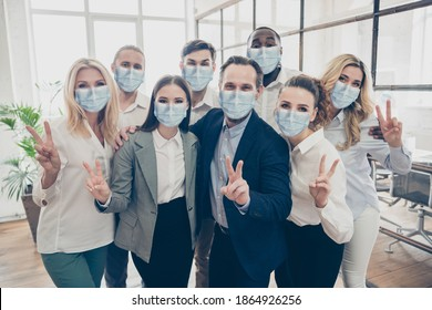 Photo of business people investors partners show v-sign wear formal clothes face mask healthcare indoors