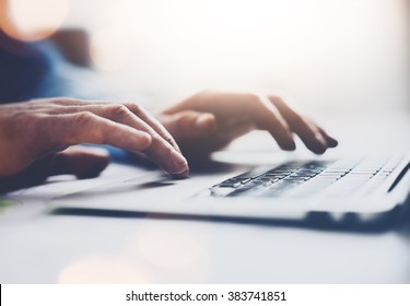 Photo businessman working with generic design notebook. Typing message, hands keyboard. Blurred background