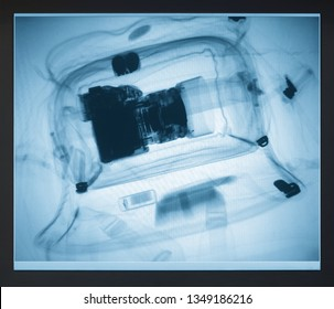 Photo camera in the bag on the x-ray monitor