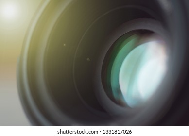 Photo camera lens close up. Abstract blurred background.