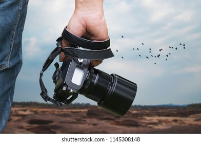 Photo camera technology. Photographer equipment. Photo creating process. Unity with nature.