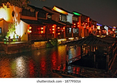 Photo of a canal in Suzhou old town in the evening, stylized and filtered to look like an oil painting