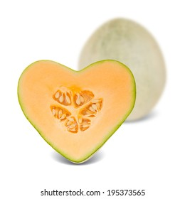 Photo of canteloupe melon with slice in a heart shape isolated on white