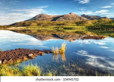Photo capture of a breathtaking natural  landscape of Connemara mountains in Ireland.