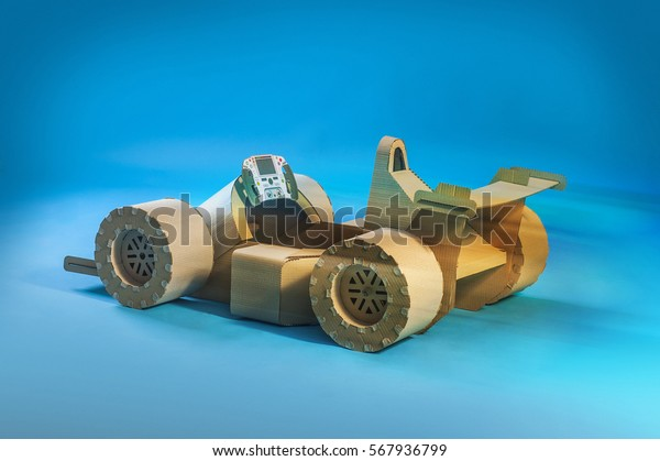 Photo Cardboard Racing Car On Blue Stock Photo (Edit Now) 567936799