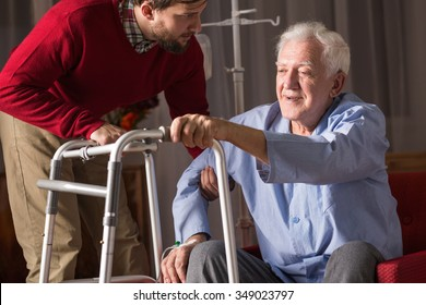 Photo of carer and person with walking disability
