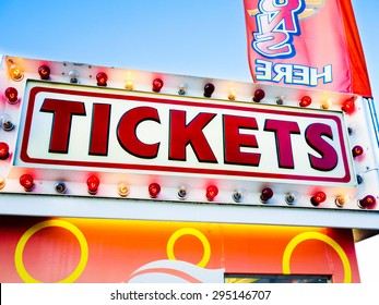 Photo of carnival tickets sign on a ticket stand. Commonly seen  at carnivals, state fairs, county fairs,  amusement parks, fesitvals, and other summer events.