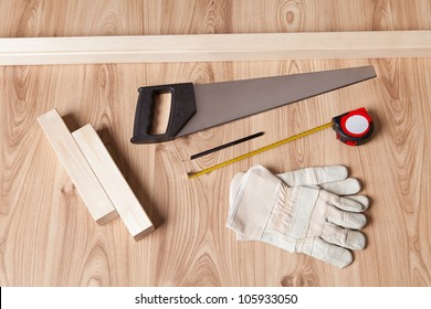Photo of carpenter tools and building plan
