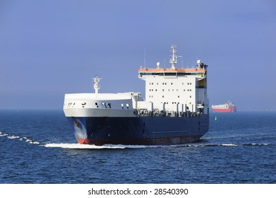 A photo of a Carrier or Freighter sailing at Sea.
