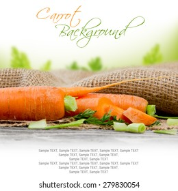 Photo of carrots with leaf on burlap with white space