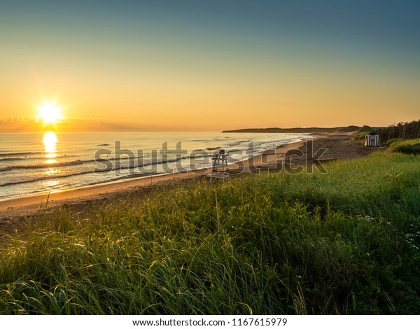 Photo of Cavendish beach on the northern coast of Prince Edward Island in Canada.