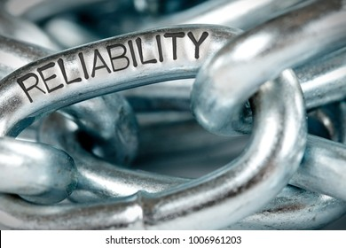 Photo of chains abstract closeup with RELIABILITY concept word imprinted on metal surface