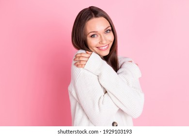 Photo of charming cheerful young lady hug herself good mood smile isolated on pastel pink color background