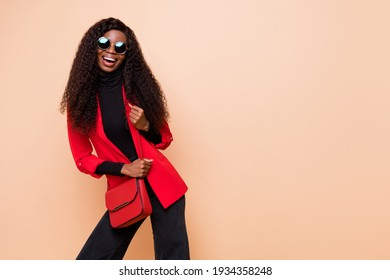 Photo of charming pretty dark skin young girl wear bag sunglass glamour isolated on beige color background