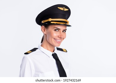 Photo of charming pretty lady beaming smile look camera wear hat aviator uniform isolated white color background
