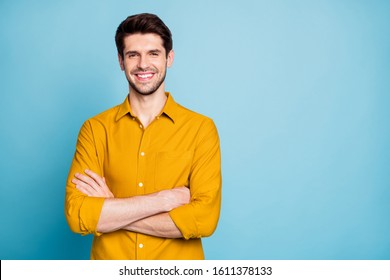 Photo of cheerful attractive handsome entrepreneur standing confidently with hands folded smiling beaming isolated over pastel color background
