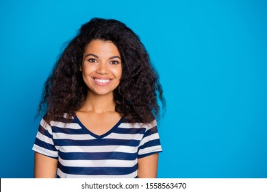 Photo of cheerful positive cute pretty girlfriend smiling toothily looking into camera near empty space isolated vivid color background