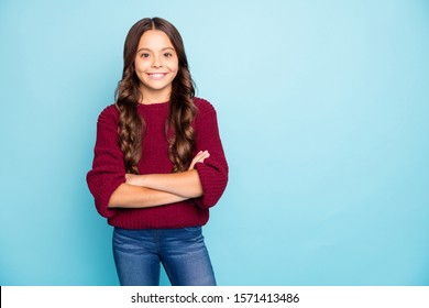 Photo of cheerful positive preteen smiling cheerfully toothily standing confidently with arms crossed isolated blue vivid color background