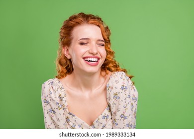 Photo of cheerful young joyful woman smile joke funny good mood face isolated on green color background