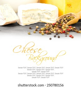 Photo of cheese cubes on wooden surface with white space for the text