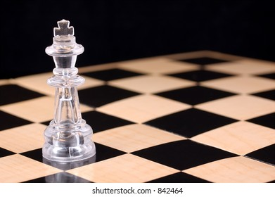 Photo of a Chess Piece and Checkered Board