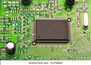 Photo of the chips on the motherboard. Macro.