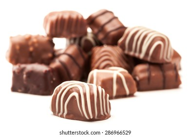Photo of chocolate pralines over white isolated background